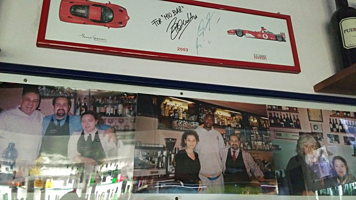 The celeb photos on the wall of Mio Bar, Bologna